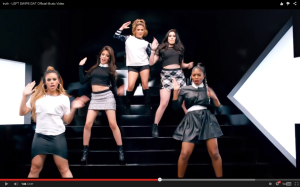 Said girl group, dancing.